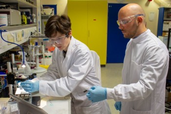 Dr Maiwenn Kersaudy-Kerhoas and Alfredo Ongaro working in the lab with PLA